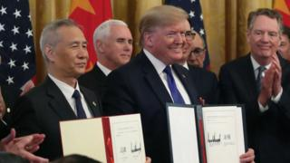 US President Donald Trump and Chinese Vice Premier Liu He, hold up signed agreements of phase 1 of a trade deal.