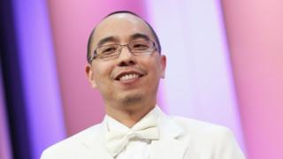 """Palme d""""Or winner for """"""""Uncle Boonmee Who Can Recall His Past Lives"""" (""""Lung Boonmee Raluek Chat"""") director Apichatpong Weerasethakul looks on during the Palme d""""Or Award Ceremony held at the Palais des Festivals during the 63rd Annual Cannes Film Festival on May 23, 2010 in Cannes, France. (Photo by Sean Gallup/Getty Images)"""
