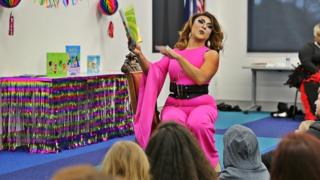 Drag Queen Princess Mocha reading to children