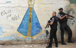 Policemen are pictured during an operation against drug dealers in Jacarezinho slum in Rio de Janeiro on 19 July, 2011