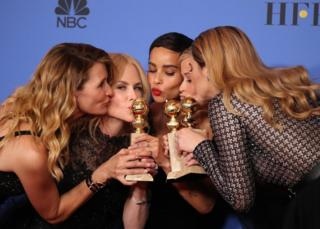 The cast of Big Little Lies kiss their Golden Globe awards.