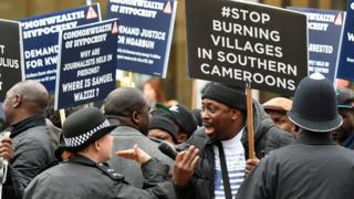 in_pictures UK police officers speak with demonstrators from Cameroon, London, UK - Monday 9 March 2020