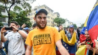 Juan Requesens greets supporters during a protest against the government of Nicolas Maduro in Caracas on April 13, 2017.