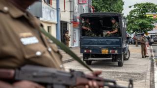 Soldiers and armed policemen guard the area near Dawatagaha Jumma Masjid before Friday prayers on April 26, 2019 in Colombo, Sri Lanka.