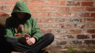 Generic picture of a young person in an alley