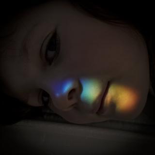 A rainbow on a girl's face