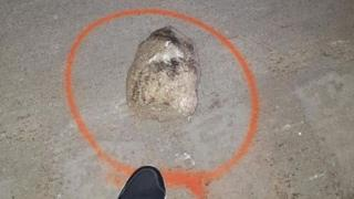 One of 20 rocks found on the highway after the incident