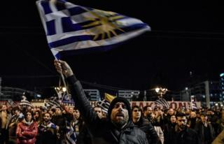 Protesters demonstrate outside the Greek Parliament