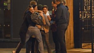 People outside a pub
