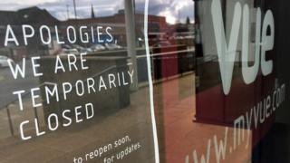 A sign in the window of a Vue cinema in Altrincham, Greater Manchester