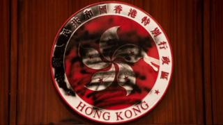 Hong Kong emblem defaced by a graffiti during the demonstration At Legco