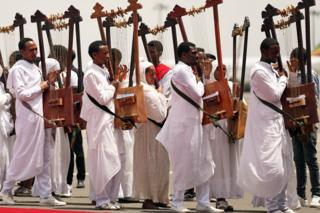 Choir members play harps during a welcome ceremony Bishop Merkorios upon returning from exile at the Bole airport in Addis Ababa, Ethiopia - Wednesday 1 August 2018