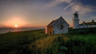 A lighthouse at sunset