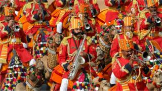 Indian Border Security Force (BSF) soldiers play music as they ride their camels during India's Republic Day parade in New Delhi, India, January, 26, 2020.