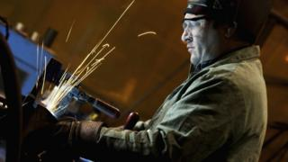 A man welding in a factory