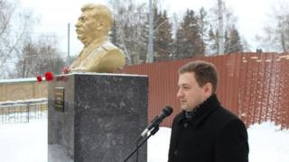 """Georgi Kamenev next to the Stalin bust at the event to announce the """"year of Stalin"""""""