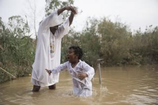 Pilgrims from Ethiopia dip at the Qasr al-Yahud baptism site in the Jordan River, West Bank near Jericho, 29 November 2018.