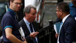 Three Conservative MPs, Oliver Letwin, Tobias Ellwood and Alok Sharma, speaking outside the Houses of Parliament