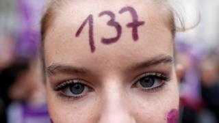 A protester with the number 137 on her forehead in Paris. Photo: 23 November 2019