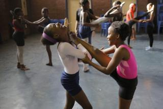 Ballet dancers from the Joburg Ballet Development School train during an afternoon class in the Alexandra Township in Johannesburg, South Africa, Monday 3 October 2016