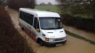 Bus stuck in flood water in Farnham