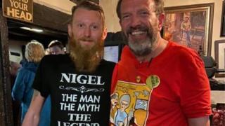 Nigel Smith with a pub goer