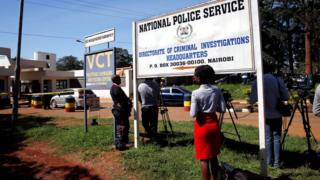 Journalists wait outside the Director of Criminal Investigation headquarters, following the arrest of the head of the National Youth Service, Richard Ndubai, along with an unspecified number of officials over corruption, in Nairobi