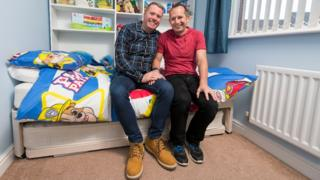 Mike and Tony in a bedroom decorated for a young boy