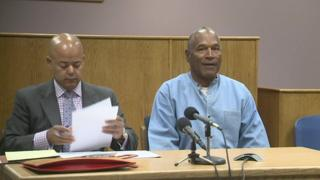 OJ seated beside his attorney