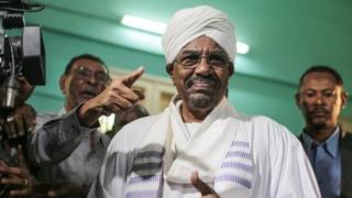President Omar al-Bashir prepares to cast his ballot as he runs for another term in Khartoum, Sudan, 13 April 2015