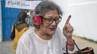 Tunisian woman shows her inked finger after casting her vote at a polling station during the presidential elections in Tunis, Tunisia on September 15, 2019.
