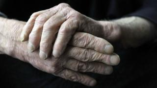 An elderly man's hands