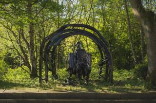 A sculpture of a miner in the Redhills grounds
