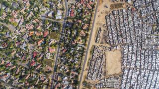 Aerial view of Kya Sands/Bloubosrand, Johannesburg, South Africa, showing a great disparity of wealth.