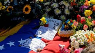 "Former elite police officer Oscar Perez""s grave identified with a brick surrounded with flowers at a cemetery in Caracas on January 21, 2018"
