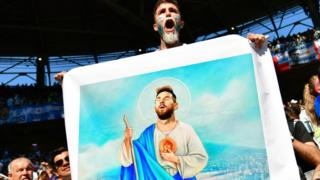 Argentine fan with Messi picture