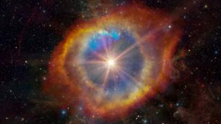"""ภาพจากฝีมือศิลปินจำลองเหตุการณ์ดาวฤกษ์ระเบิดภายในเนบิวลา """"ดวงตาของพระเจ้า"""" หรือฮีลิกซ์เนบิวลา (Helix Nebula)"""