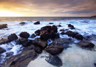 A peaceful morning at Mosquera Islet, near Santa Cruz Island, with the Sally Lightfoot crabs