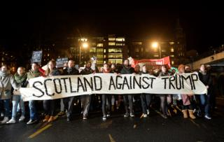 """Demonstrators march from the Mound to the Scottish Parliament to protest against President Trump""""s Muslim travel ban to the USA on January 30, 2017 in Edinburgh, Scotlan"""