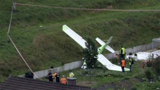 A small plane on the ground at the scene of a crash in Dittingen, Switzerland, 23 August 2015.