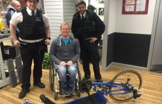 Tim Farr and two police officers with his bike