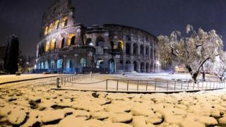 The Colosseum is covered by snow during a snowfall in Rome, Italy, 26 February 2018.