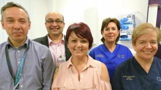 A photo of Debbie with the maxillofacial team at Morriston Hospital
