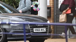 People leave Kents Hill Park near Milton Keynes
