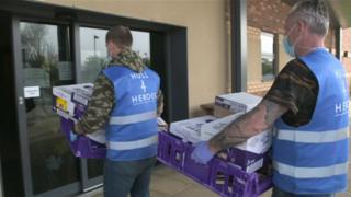Staff delivering food parcels