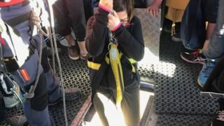 Jennifer Jones starts her descent from the cable car