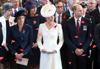 Theresa May and The Duke and Duchess of Cambridge watch poppies fall