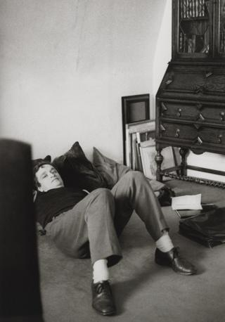 Sir Norman Rosenthal lies on the floor of his flat, 1981-1982