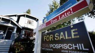 A real estate for sale sign is pictured in front of a home in Vancouver, British Columbia, Canada, September 22, 2016