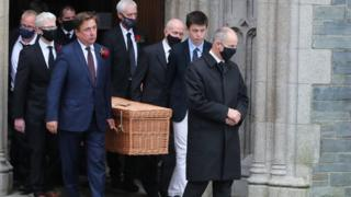 Northern Ireland John Hume's coffin leaving St Eugene's Cathedral